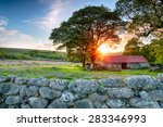 Sunset Over An Old Barn At...