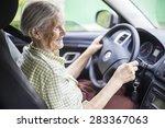 cheerful senior woman driving a ... | Shutterstock . vector #283367063