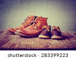 daddy's boots and baby's shoes  ...   Shutterstock . vector #283399223