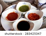 set of sauces on a white plate... | Shutterstock . vector #283425347