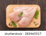 raw chicken breast fillets on... | Shutterstock . vector #283465517