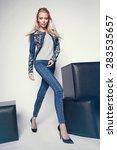 beautiful young woman in denim...   Shutterstock . vector #283535657