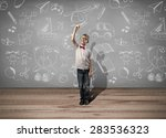 boy drawing picture | Shutterstock . vector #283536323