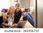 father and daughter using... | Shutterstock . vector #283556753