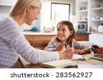 mother teaching her daughter at ... | Shutterstock . vector #283562927