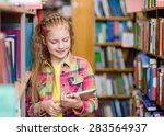 young girl using a tablet... | Shutterstock . vector #283564937