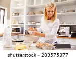 woman baking at home following... | Shutterstock . vector #283575377