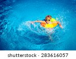 happy child playing in swimming ... | Shutterstock . vector #283616057