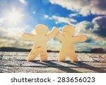 Wooden Little Men Holding Hand...