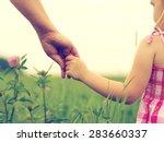 hands of mother and daughter... | Shutterstock . vector #283660337