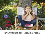 young girl sitting outdoors in... | Shutterstock . vector #283667867
