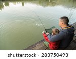 Dad And Son Go Fishing On The...