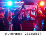 energetic friends dancing in... | Shutterstock . vector #283865597