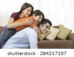 happy indian family of three at ... | Shutterstock . vector #284217107