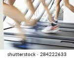 close up of 3 runners feet on... | Shutterstock . vector #284222633
