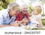Grandparents And Granddaughter...