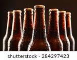 Glass Bottles Of Beer On Dark...
