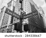 a closeup to signs for east... | Shutterstock . vector #284338667