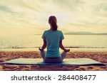 young woman meditating in pose... | Shutterstock . vector #284408477