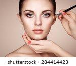 Makeup Artist Applies Skintone...