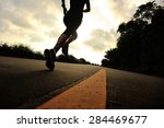 runner athlete running at... | Shutterstock . vector #284469677