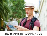 happy young man with a map | Shutterstock . vector #284474723