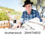 senior gentleman reading... | Shutterstock . vector #284476853