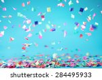 colored confetti flying on blue