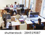Small photo of Wide Angle View Of Busy Design Office With Workers At Desks