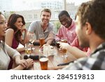 group of friends enjoying drink ... | Shutterstock . vector #284519813
