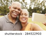senior couple taking selfie in... | Shutterstock . vector #284522903
