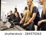 teacher helping students... | Shutterstock . vector #284570363