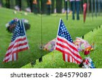 American Flag Sits Next To A...