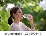 portrait of woman drinking... | Shutterstock . vector #284697947