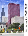Small photo of CHICAGO, ILLINOIS - SEPTEMBER 6: CNA Plaza and Willis Tower on September 6, 2012 in Chicago, Illinois. Willis Tower, also known as Sears Tower, was the tallest building in the world from 1973 to 1998.