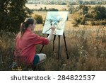 Young Girl Artist Is Painting...
