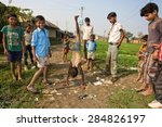 Small photo of RAXAUL - NOV 7: Unidentified Indian children playing on Nov 7, 2013 in Raxaul, Bihar state, India. Bihar is one of the poorest states in India. The per capita income is about 300 dollars.