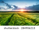 Sunset Over Farm Land With...
