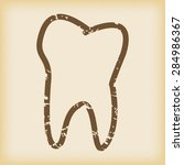 grungy brown icon with tooth...
