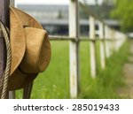 Cowboy Hat And Lasso On Fence...