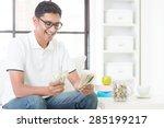 happy indian guy counting money ...   Shutterstock . vector #285199217