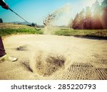Golfer Hitting Out Of A Sand...