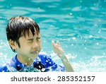 asia little boy at swimming... | Shutterstock . vector #285352157