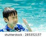 asia little boy at swimming... | Shutterstock . vector #285352157