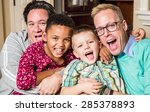 gay parents pose with their... | Shutterstock . vector #285378893