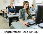 young beautiful girl working on ... | Shutterstock . vector #285434387
