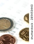 coins on financial report. | Shutterstock . vector #285453443