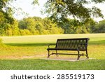 Black Park Bench In A Park...