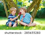 two hungry little kid boys... | Shutterstock . vector #285655283