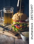 delicious burger stacked high... | Shutterstock . vector #285732497